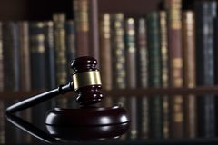 Law theme – court library. Gavel of the jugde in the court library Royalty Free Stock Image