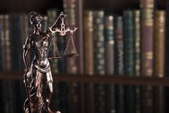 Law theme – court library. Statue of justice in the court library Royalty Free Stock Photos