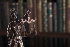 Law theme – court library. Statue of justice in the court library Stock Image
