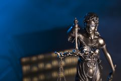 Law theme. Blind justice symbol - Themis. Law code. Statue of justice and  books. Blue background. Place for text Stock Photo