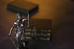 Law theme. Blind justice symbol - Themis. Law code. Statue of justice and  books. Brown background. Place for text Stock Photos