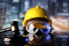 Construction law. Law theme. Construction law`s symbols  - helmet and gavel. Constuction background Royalty Free Stock Image