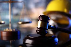 Construction law. Law theme. Construction law`s symbols  - helmet and gavel. Constuction background Stock Photo