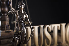 Law theme. Justice concept. Gavel of the judge. Lady justice. Scale. Wooden table stock photography