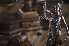 Law theme. Justice concept. Gavel of the judge. Lady justice. Scale. Wooden table stock images