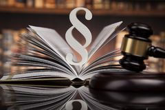 Law books, Paragraph justice concept, Court gavel. Law theme, mallet of the judge, justice scale, books, wooden desk stock images
