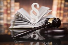 Law books, Paragraph justice concept, Court gavel. Law theme, mallet of the judge, justice scale, books, wooden desk royalty free stock photo