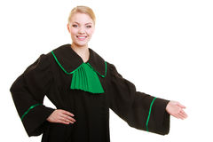 Law. Woman lawyer in polish gown inviting welcome Stock Photography