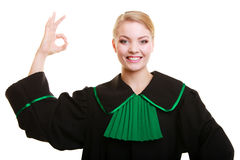 Law. Woman lawyer in polish gown showing ok Stock Image