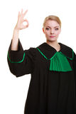 Law. Woman lawyer in polish gown showing ok okay. Stock Photography