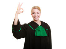 Law. Woman lawyer in polish gown showing ok okay. Royalty Free Stock Image