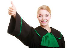 Law. Woman lawyer in polish gown showing thumb up Stock Image