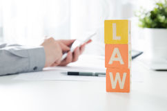 LAW word from toy blocks. Lawyer working in background Stock Images