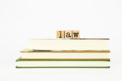 Law word on wood stamps and books books Stock Image