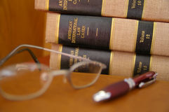 Law work. Law books stacked with glasses and pen Royalty Free Stock Photo