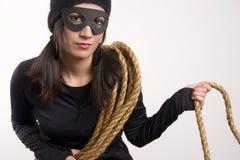 Masked Female Bandit Wears Black White Background stock photo