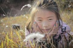 Lawn asian little girl Stock Image