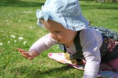 Lawn baby. A baby on a green lawn royalty free stock photography