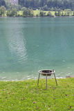 Lawn for barbecue on the shore of mountain lake Stock Photography