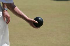 Lawn Bowl. An forearm of an older gentleman on the green royalty free stock photography