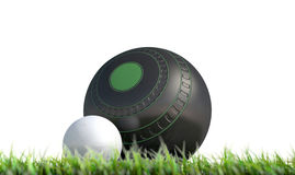Lawn Bowl And Jack. A wooden lawn bowling ball next to a white jack in the grass on an isolated white background - 3D render Stock Image