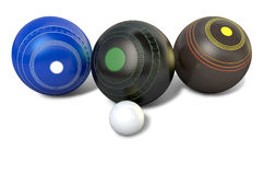 Lawn Bowls And Jack. Three different designs of lawn bowling balls surrounding a white jack on an isolated white studio background - 3D render Royalty Free Stock Images