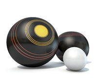 Lawn Bowls And Jack. Two wooden lawn bowling balls surrounding a white jack on an isolated white studio background Stock Photo