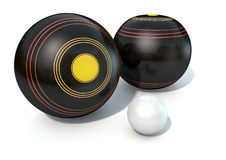Lawn Bowls And Jack. Two wooden lawn bowling balls surrounding a white jack on an isolated white studio background Stock Image