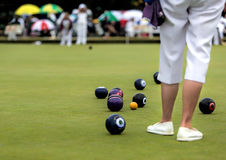 Lawn Bowls Match. Ladies playing a game of lawn bowls stock photo