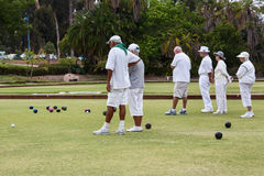 Lawn bowls seniors white clothing Royalty Free Stock Photography