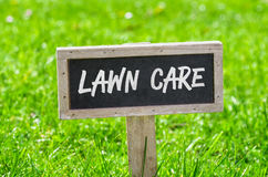 Lawn care. Sign on a green lawn - Lawn care Stock Images