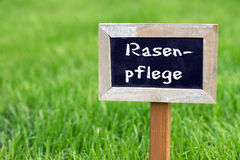 Lawn care. Sign with the words Lawn care stands on the green lawn royalty free stock photography