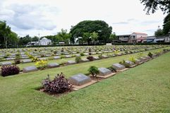 Lawn in a cemetery with headstones Royalty Free Stock Image