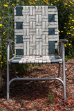 Lawn chair in garden Royalty Free Stock Images