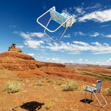 Lawn chairs in desert. Royalty Free Stock Images