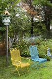 Lawn Chairs in Garden Royalty Free Stock Images