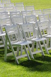 Lawn chairs on grass Royalty Free Stock Images