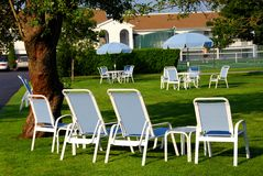 Lawn chairs hotel Stock Photography