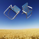 Lawn Chairs Over Wheat Field. Stock Images