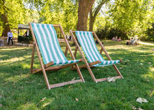 Lawn chairs in the park Stock Photo