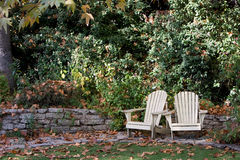 Lawn Chairs for Relaxing. Two lawn chairs wait on an autumn afternoon in a southern California backyard for someone to come and relax in them royalty free stock photography