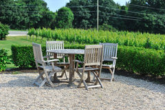 Lawn chairs by the vineyard Stock Images