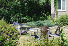 Lawn chairs in yard. Lawn chairs in front yard royalty free stock images