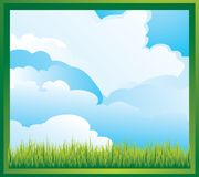Lawn and cloudy sky. Green grass and blue sky with white clouds Royalty Free Stock Photo