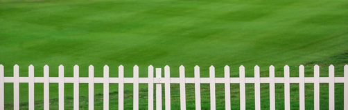 Lawn and fence royalty free stock images