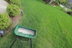 Lawn Fertilizer. Spreader on grass Stock Images