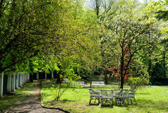 Lawn furniture in garden Royalty Free Stock Image