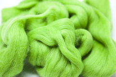 Lawn   green piece of Australian sheep wool Merino breed close-up on a white background Royalty Free Stock Images