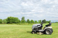 Lawn with lawn mower Stock Image