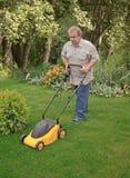 lawn man mower Стоковое фото RF